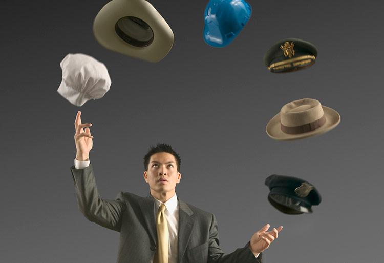 Businessman-Juggling-Hats-750-crop